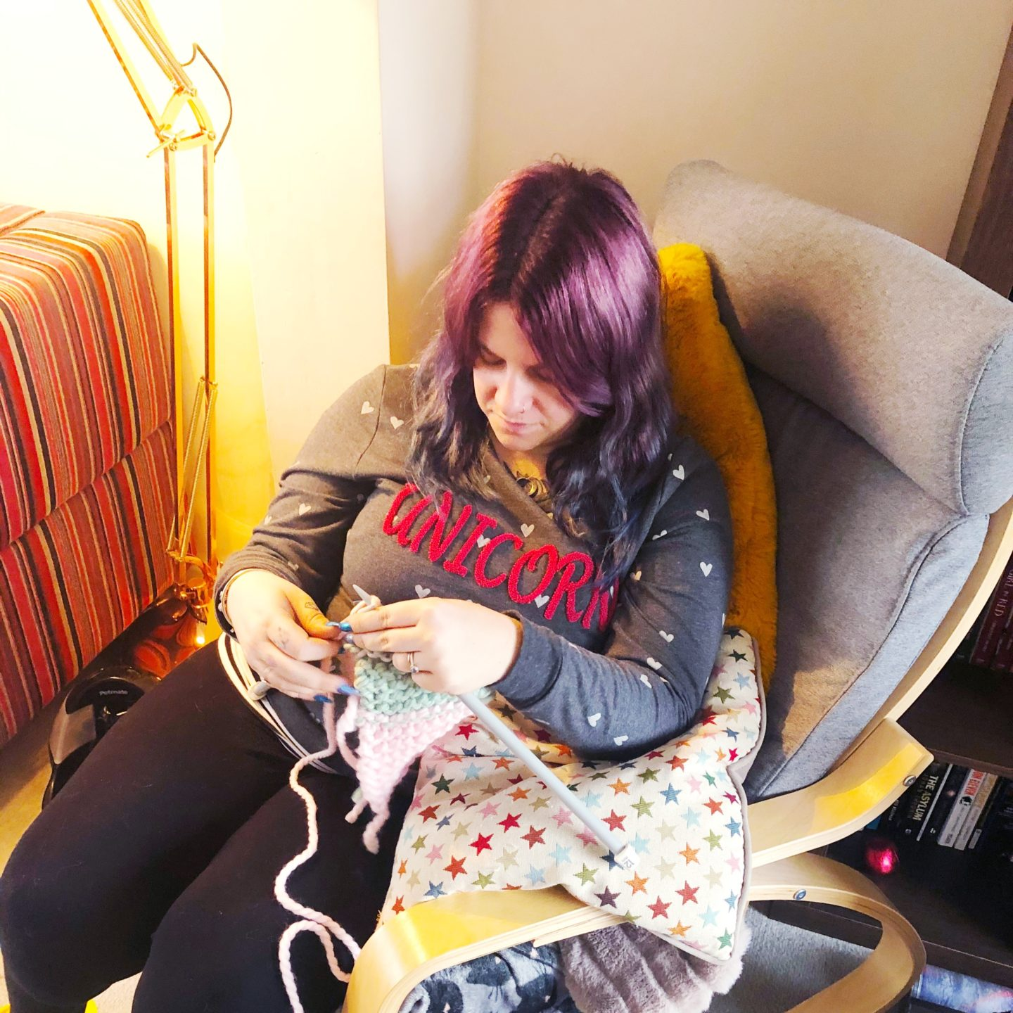 Estelle sat in a rocking chair knitting